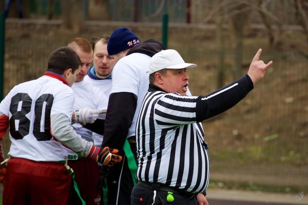 Flag-football referee Gleb Dyakonov announces second down for Marvel team