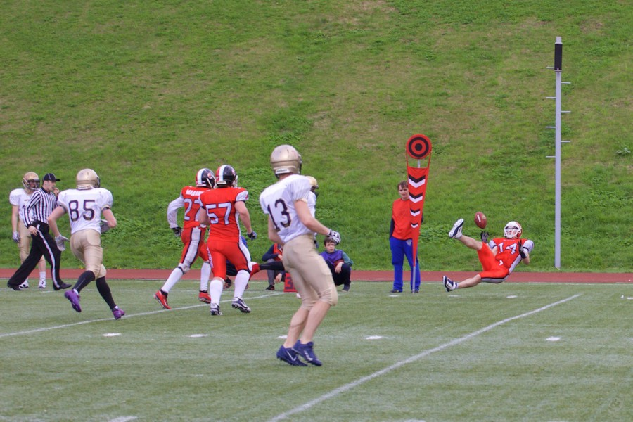 Rebels safety Pavel Maximishin (#14) trying to intercept the ball