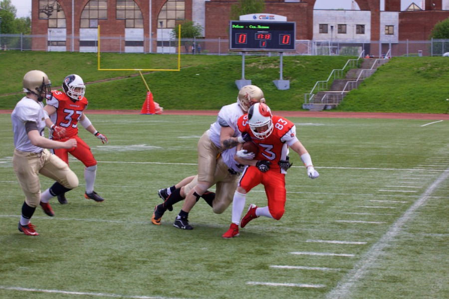 Rebels tight-end Pavel Kozhlin carrying the ball