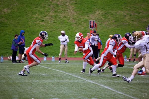 Rebels quarterback Dmitry Barshev (#7) handling the ball to runningback Pavel Maximishin (#14)