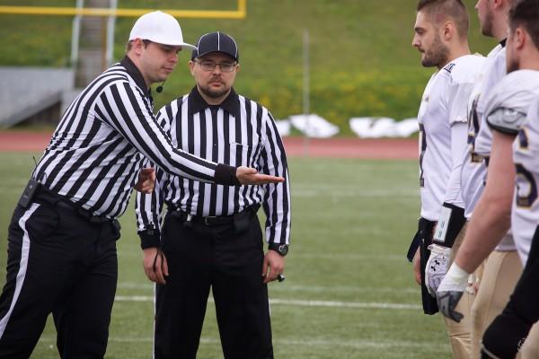 Head referee Kirill Chekhov and umpire Vladimir Platonov on the coin toss