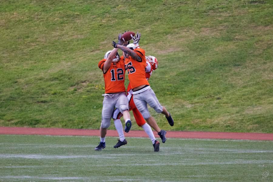 Patriots' defensive backs intercepting the pass
