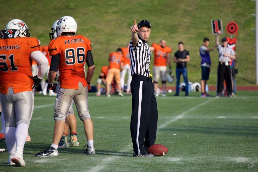 Umpire Maxim Morozov announcing the Patriots' first down