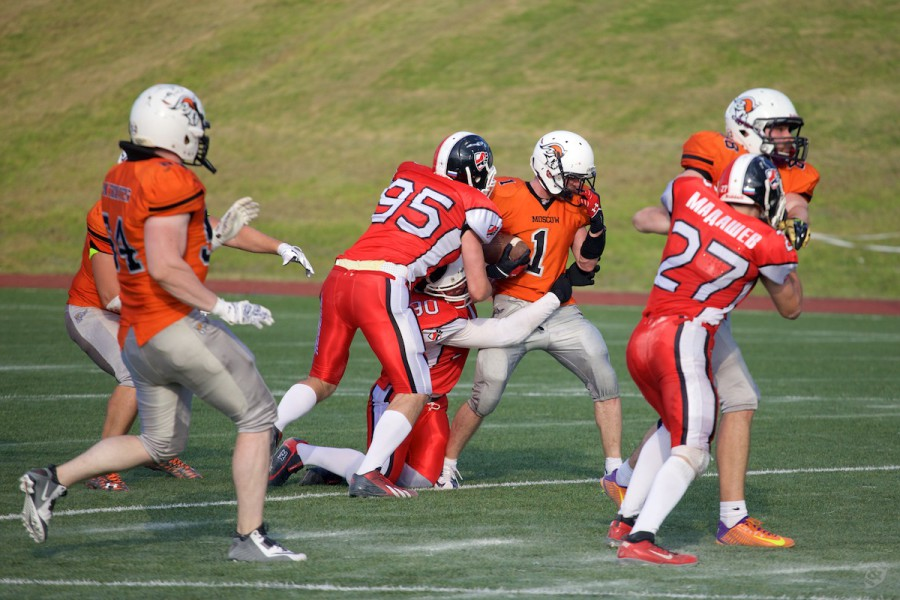 Patriots returner Viktor But (#1) getting tackled by Rebels special team