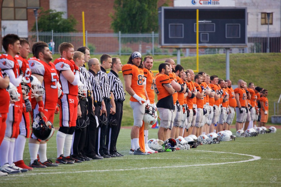 Patriots, Rebels and match officials listening the national anthem