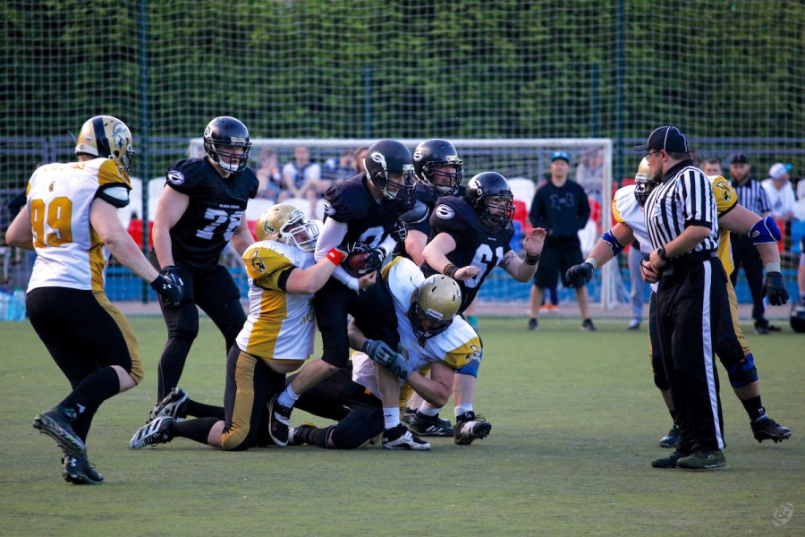 Black Storm quarterback Artur Dryakhlov (#2) recovering the bad snap