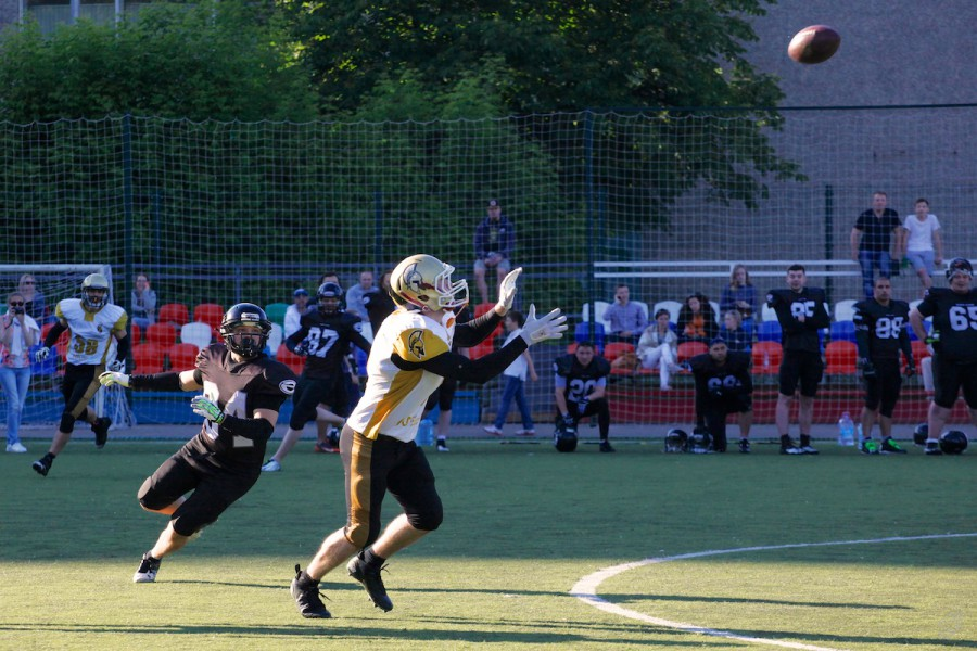 Spartans cornerback Sergey Kalashnikov (#8) intercepting the ball