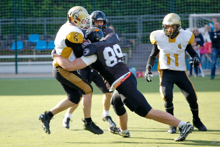 Spartans cornerback Sergey Kalashnikov (#8) getting tackled by Alexey Egorov (#89)