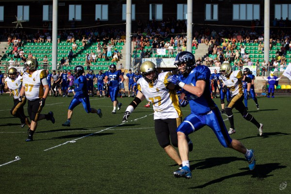 August 22, 2015 / Pushkin, Leningrad Region, Russia / Griffins free safety Fedor Akimov (#23) rushing with ball after interception / © First&Goal (firstandgoal.ru) / Mikhail Klaviaturov