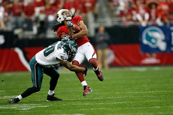eagles-safety-brian-dawkins-tackles-cardinals-receiver-larry-fitzgerald