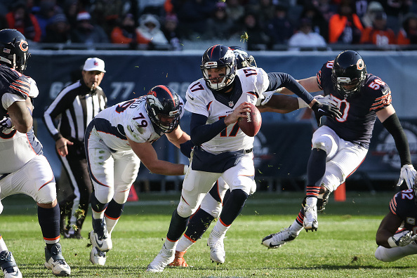 CHICAGO, IL - NOVEMBER 22: Quarterback Brock Osweiler #17 of the Denver Broncos carries the football in the third quarter against the Chicago Bears at Soldier Field on November 22, 2015 in Chicago, Illinois. (Photo by Jonathan Daniel/Getty Images)