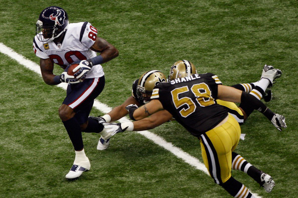 NEW ORLEANS, LA - SEPTEMBER 25: Andre Johnson #80 of the Houston Texans avoids a tackle by Scott Shanle #58 of the New Orleans Saints at Louisiana Superdome on September 25, 2011 in New Orleans, Louisiana. (Photo by Chris Graythen/Getty Images)