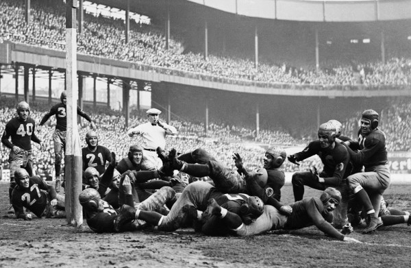 Washington Redskins back Cliff Battles (20) scores against the New York Giants in 1937 game played on Dec. 5, 1937 at the Polo Grounds. Redskins, with Battles and Sammy Baugh, smashed Giants, 49-14, to win eastern division champions of the NFL. (AP Photo)