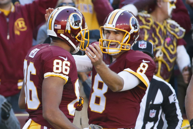 Washington Redskins quarterback Kirk Cousins (8) congratulates teammate tight end Jordan Reed (86) after his touchdown during the first half of an NFL football game against the New Orleans Saints in Landover, Md., Sunday, Nov. 15, 2015. (AP Photo/Alex Brandon)