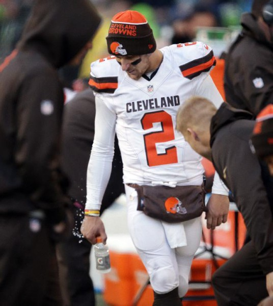 Cleveland Browns quarterback Johnny Manziel stands on the sidelines late in the second half of an NFL football game against the Seattle Seahawks, Sunday, Dec. 20, 2015, in Seattle. The Seahawks won 30-13. (AP Photo/Scott Eklund)