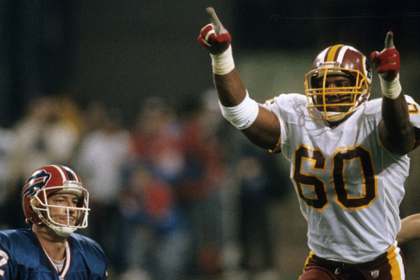 Washington Redskins defensive end Fred Stokes (60) celebrates a 4th quarter sack of Bills Hall of Fame quarterback Jim Kelly (12) during the Redskins 37-24 victory over the Buffalo Bills in Super Bowl XXVI on January 26, 1992 at the Hubert H. Humphrey Met (AP Photo/NFL Photos)