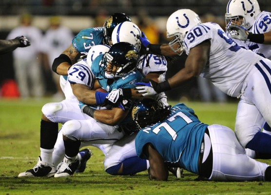 JACKSONVILLE, FL - DECEMBER 17: Maurice Jones-Drew #32 of the Jacksonville Jaguars is stopped by the Indianapolis Colts at Jacksonville Municipal Stadium on December 17, 2009 in Jacksonville, Florida. (Photo by Sam Greenwood/Getty Images)