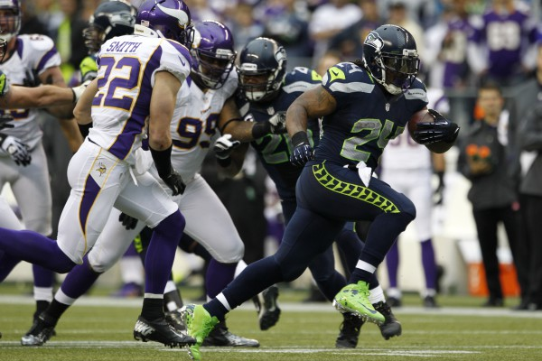 Seattle Seahawks' Marshawn Lynch (24) rushes against the Minnesota Vikings in the second half of an NFL football game, Sunday, Nov. 4, 2012, in Seattle. (AP Photo/Elaine Thompson)
