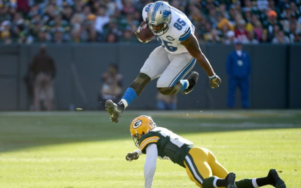 Nov 15, 2015; Green Bay, WI, USA; Detroit Lions tight end Eric Ebron (85) leaps over Green Bay Packers cornerback Damarious Randall (23) in the second quarter at Lambeau Field. Mandatory Credit: Benny Sieu-USA TODAY Sports