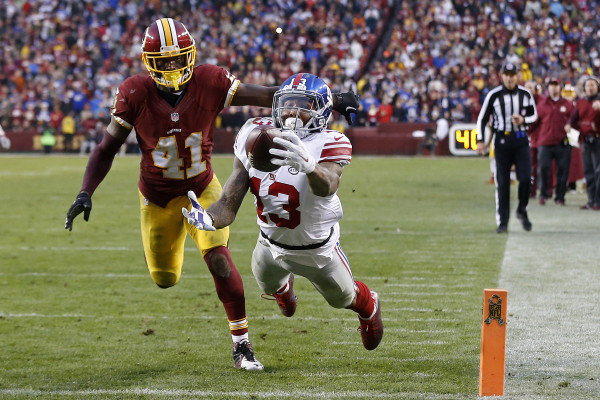 Nov 29, 2015; Landover, MD, USA; New York Giants wide receiver Odell Beckham (13) catches a touchdown pass as Washington Redskins cornerback Will Blackmon (41) defends in the fourth quarter at FedEx Field. The Redskins won 20-14. Mandatory Credit: Geoff Burke-USA TODAY Sports ORG XMIT: USATSI-224780 ORIG FILE ID: 20151129_ads_sb4_163.JPG