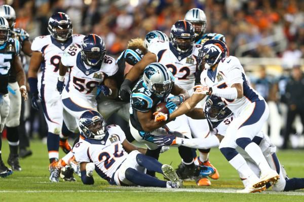 Feb 7, 2016; Santa Clara, CA, USA; Carolina Panthers running back Fozzy Whittaker (43) is tackled by members of the Denver Broncos defense in the third quarter in Super Bowl 50 at Levi's Stadium. Mandatory Credit: Mark J. Rebilas-USA TODAY Sports ORG XMIT: USATSI-245820 ORIG FILE ID: 20160207_jla_su5_243.jpg