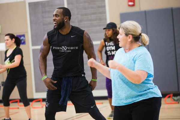 "Kam Chancellor smiles as he joins participants towards the back of the room to exercise with them during a Form by Force Women's Boot Camp at the Gymnasium at Les Gove Park in Auburn on Wednesday, March 30, 2016. The Seahawks safety hosts the workouts, along with Kevin Allen, his personal trainer and co-owner of Form by Force. ""Special guests,"" like teammate Richard Sherman, sometimes make appearances."