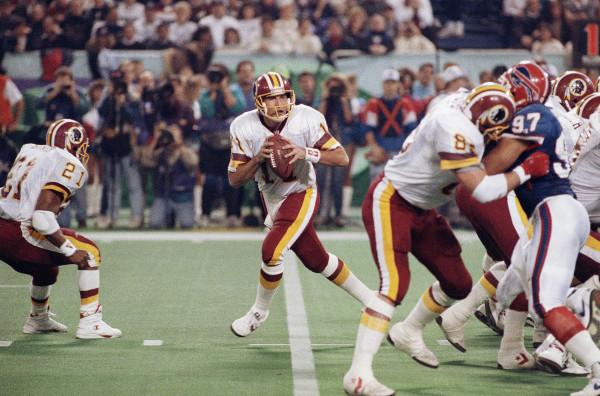 Washington Redskins Don Warren (85) keeps Buffalo Bills Cornelius Bennet (97) away from Redskins quarterback Mark Rypien during second quarter action Super Bowl XXVI football game in Minneapolis, on Sunday, Jan. 27, 1992. (AP Photo/Jim Mone)