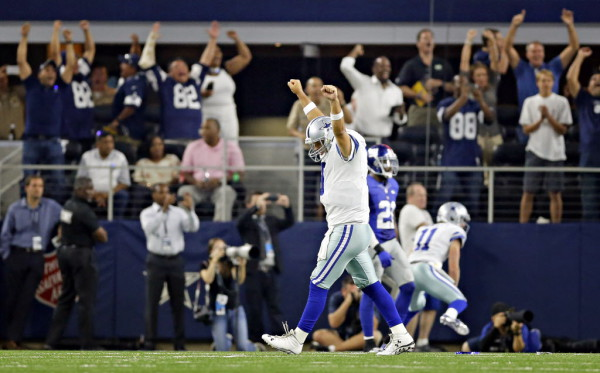 Dallas Cowboys quarterback Tony Romo his game-winning touchdown to tight end Jason Witten during the final seconds of a 27-26 win over the New York Giants Sunday, September 13, 2015 at AT&T Stadium in Arlington, Texas. (G.J. McCarthy/The Dallas Morning News)