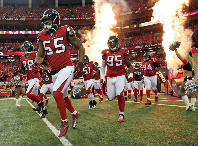 011313 ATLANTA : The Falcons defense led by John Abraham takes the field to play the Seahawks in their NFL divisional playoff game at the Georgia Dome in Atlanta on Sunday, Jan. 13, 2013. CURTIS COMPTON / CCOMPTON@AJC.COM