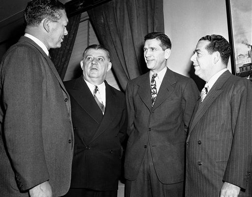 "Four of the professional footballers attending the NFL meeting hold a pre-session parley in New York City, April 6, 1945. Left to right: Earl ""Curly"" Lambeau, head coach of Green Bay Packers; Bert Bell, president of the Pittsburgh Steelers; Elmer Layden, NFL president; and Fred L. Mandel, Detroit Lions owner. (AP Photo/Harry Harris)"