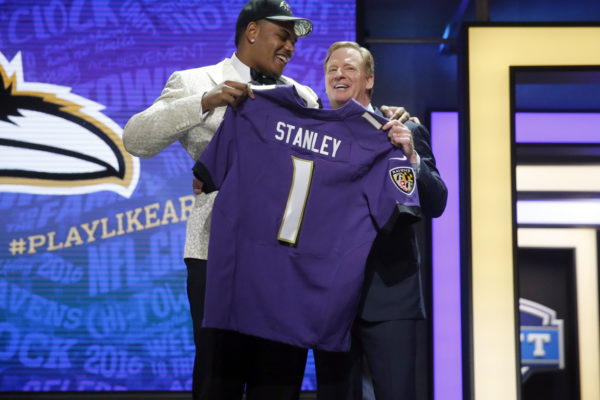 Notre Dame's Ronnie Stanley poses for photos with NFL commissioner Roger Goodell after being selected by Baltimore Ravens as the sixth pick in the first round of the 2016 NFL football draft, Thursday, April 28, 2016, in Chicago. (AP Photo/Charles Rex Arbogast)